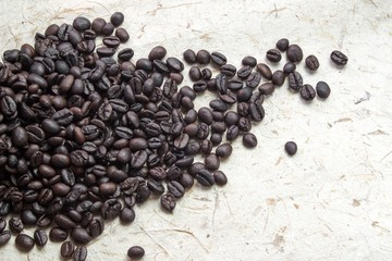 Coffee on grunge wooden background. Fresh coffee beans on wood, ready to brew delicious coffee