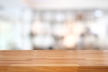 Empty wooden table and modern blurred background
