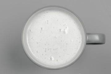 top view of glass milk / Glass of Milk From Above / gray tone