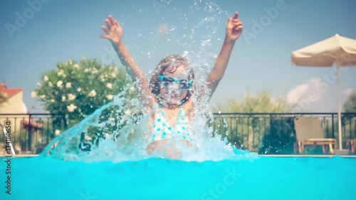Happy Child Playing In Swimming Pool Girl Having Fun Outdoors Summer Vacation And Holiday