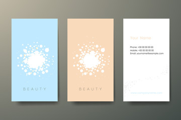 Set of three light vertical abstract business cards with graphic elements and text on grey background.