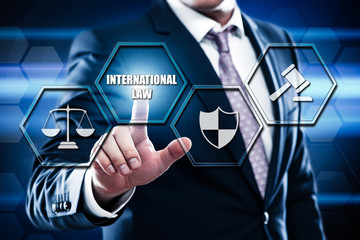 Business, technology, internet concept on hexagons and transparent honeycomb background. Businessman pressing button on touch screen interface and select international law