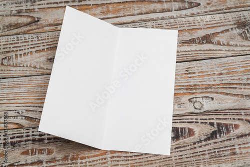 bifold white template paper on wood texture fotolia com の