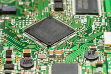 Close up of electronic circuit board with microchip and components