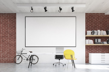 Home office with yellow chair and whiteboard