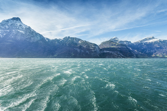 Alps Canton of Uri. Switzerland. Mountain landscape. Windy day on the lake. Dynamic clouds in the sky.