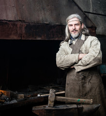 Portrait of a village blacksmith in the smithy