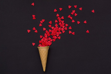 waffle cone and a lot of small hearts on a black background