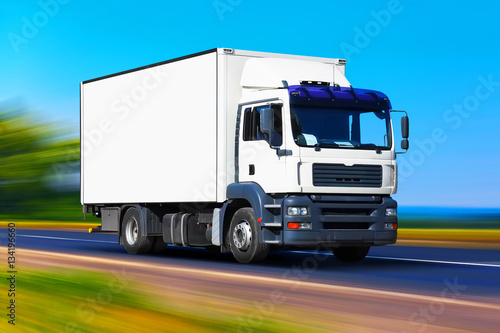 """""""White delivery truck on the road"""" Stock photo and royalty ..."""