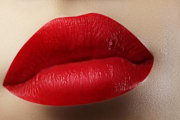 Beautiful female Lips. Sweet Kiss with red lipstick. Lip Make-up on macro shoot. Hot fashion lip makeup