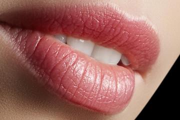 Sweet kiss. Perfect natural lip makeup. Close up macro photo with beautiful female mouth. Plump full lips