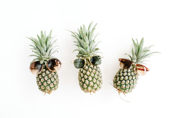 Pineapples in sunglasses. Flat lay, top view