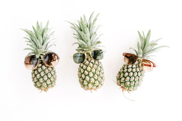 Hipster pineapples in sunglasses. Flat lay, top view