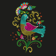 Embroidery colorful ethnic floral pattern. Vector traditional folk bird with flowers ornament on black background.