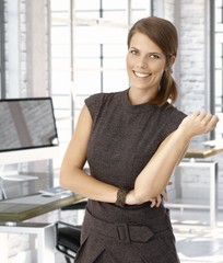 Happy caucasian businesswoman at office desk