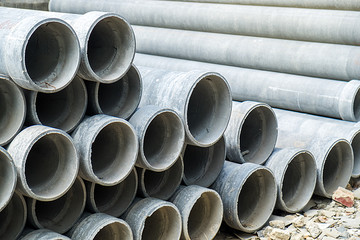 Stacked of Industrial concrete drainage pipes for construction