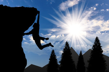 Climbing climber on top of mountain on background of mountain scenery