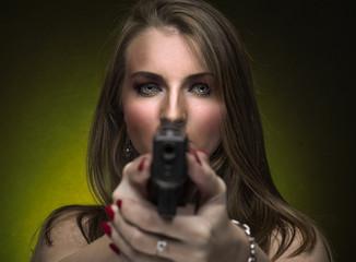 Woman holding two handguns