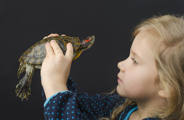 Little girl and turtle in the studio