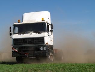 Drifting truck makes huge dust cloud