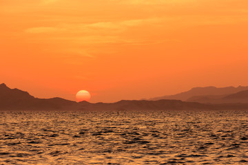 The sunrise over the island of Tiran.