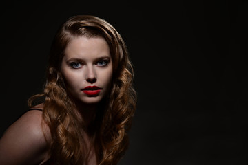 headshot woman with 1940s style hair