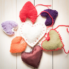 Valentine's Day. Colorful knitted hearts. Valentines day. Heart pendant. Red heart. Handmade Hearts. Valentine cards. Space for text.