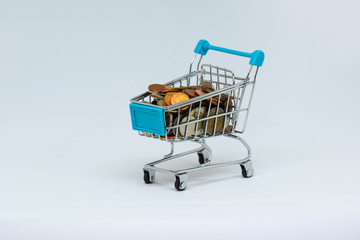 Closeup of shopping cart full load coin. Financial concept