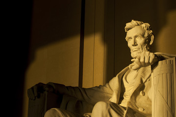 Statue of Abraham Lincoln in brilliant warm dramatic morning sunlight
