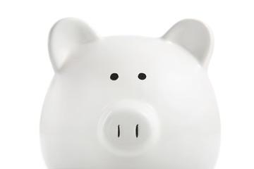 White piggy bank on a white background