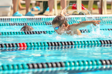 Boy swimming Butterfly in a race
