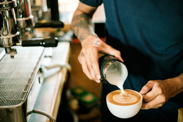 Fototapeta Baristas are coffee,by tattooed barista arm obraz