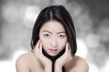 Pretty woman on bokeh background