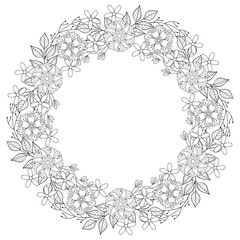 Floral zentangle doodles wreath in ornamental style. Vector circ