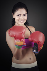 Woman standing with boxing gloves