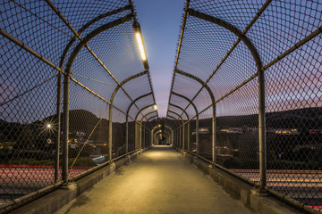 Pedestrian Footbridge with Long Exposure of US 101 Traffic Lights During Sunset in Agoura Hills, Los Angeles County