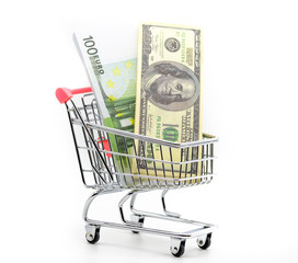 Dollars and euro cash in shopping trolley isolated on white