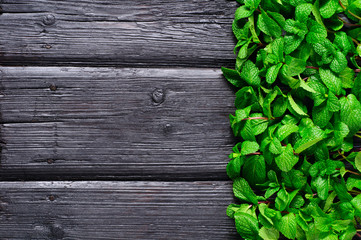 mint sheaf charred on the old wooden background