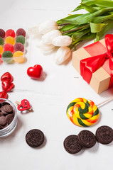 composition with tulips, sweets, candies and gift box. valentine's or mother' day.
