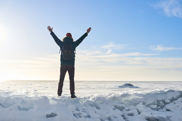 Man on the top. Finish of the way. Ice desert in sunny day. Concept of win. Champion of foot travel. Openning new horizont. Free space for advertising. Victory.