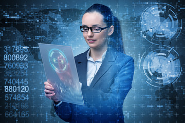 Businesswoman with tablet in business concept