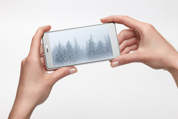 Female hands holding smartphone with picture