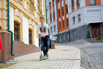 happy boy travel on kick scooter