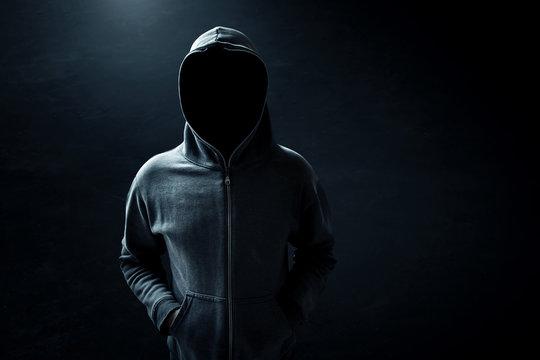 Hacker standing alone in dark room