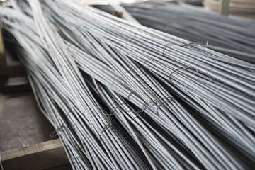 Stack of round steel bar used for construction.