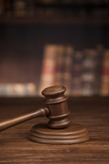 Law and justice concept, Brown wooden background