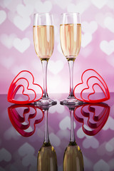 Celebration with champagne and rose, mirror background