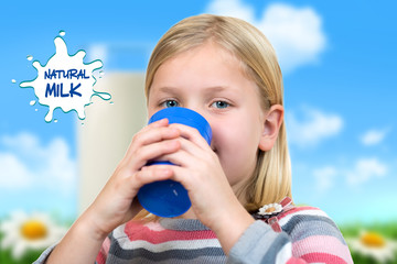 Healthcare and medicine concept - ill little girl with flu holding cup of hot tea or milk.