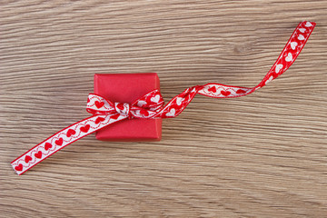 Wrapped gift with red ribbon for Valentines Day