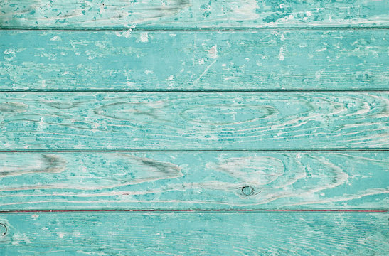 The old wide ugly shabby endured structure. Ancient horizontal wooden rough simple background. Turquoise,  wood.